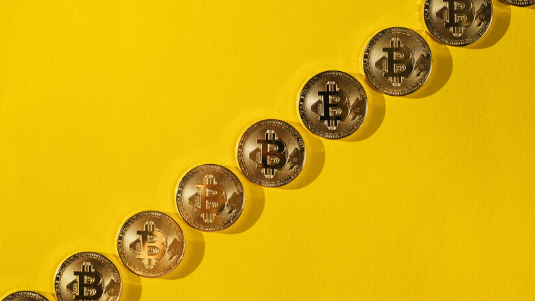 bitcoins on yellow background